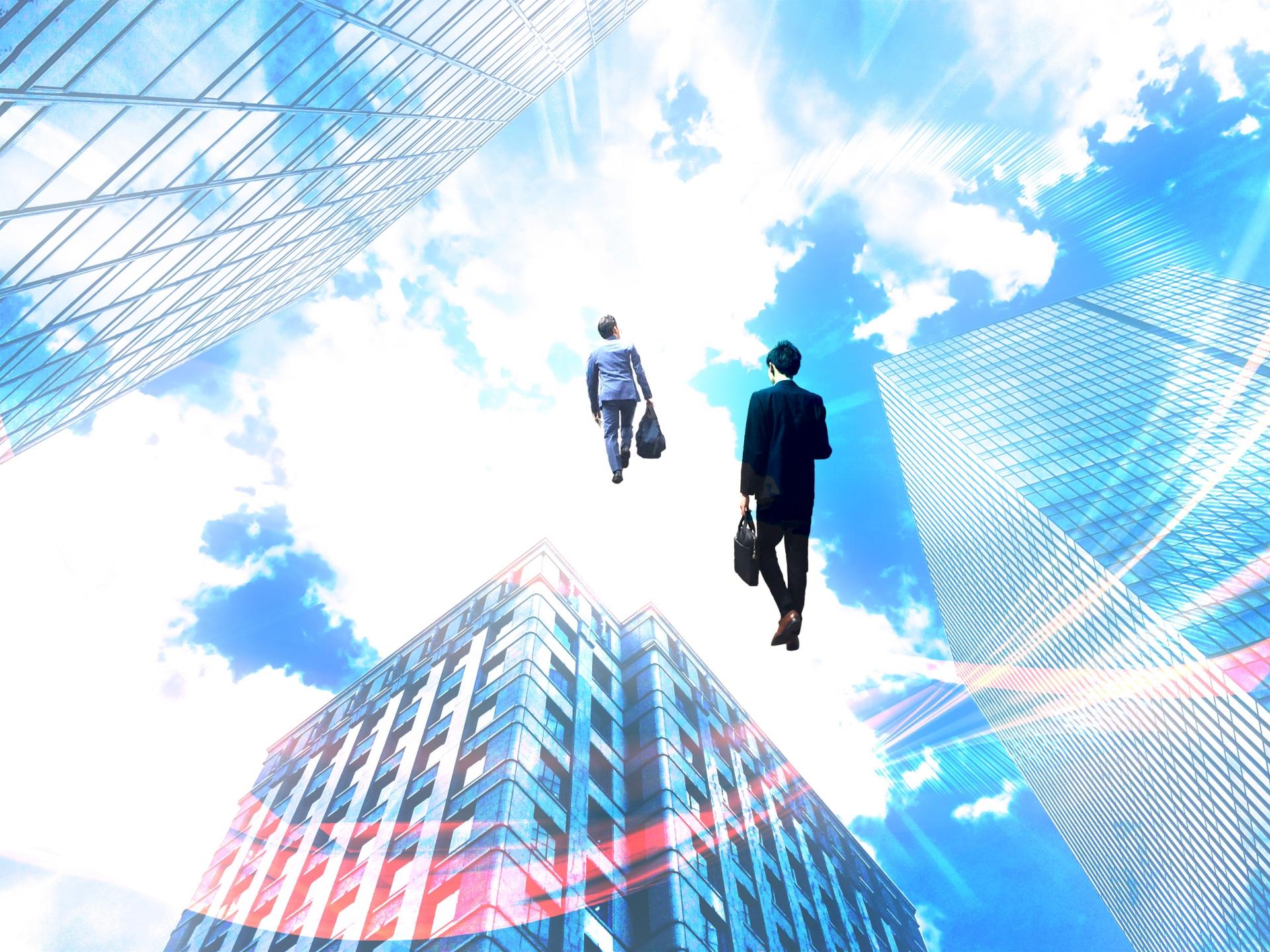 空に飛び立つビジネスマン